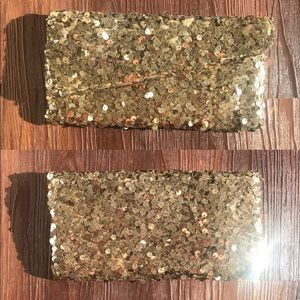 Charming Charlie gold sequin clutch